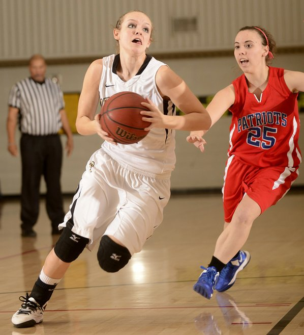 Bentonville's Taylor Lee, left, drives ...