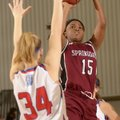 Springdale's Jayvonda Daniels, right, shoots the ball over Seneca (Mo.) defender Elena Wood during W...