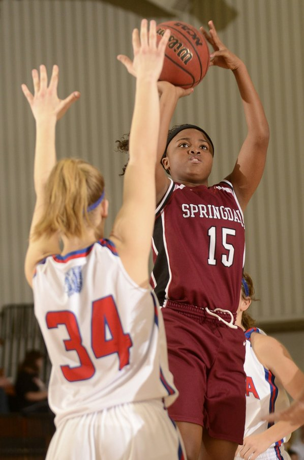 Springdale's Jayvonda Daniels, right, shoots ...