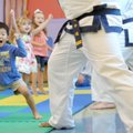 Liam Condray, 4, of Fayetteville yells Tuesday, Sept. 11, 2012, while learning some basics about kar...