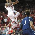 Arkansas sophomore guard B.J. Young  floats to the goal as Longwood freshman guard Nik Brown Sunday,...
