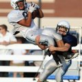 Springdale Har-Ber receiver Miguel Salgado leaps for a catch as cornerback Ben Schaffer makes the ta...