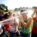 Lowell Elementary fourth-grader Brooklyn Beebe covers her face while she and fellow classmates take ...