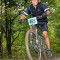 A competitor in the 2012 Northwest Arkansas Mountain Bike Championship tops a hill at Devil's Den St...
