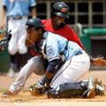 Frisco's Jurickson Profar is tagged out at home by Naturals catcher Julio Rodriguez during the first...