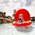 McKayla Cawood, 14 months, floats around in the pool at Paradise Valley Golf & Athletic Club in Faye...