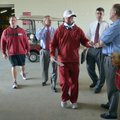 University of Arkansas coach Bobby Petrino heads into a press conference before practiceTuesday afte...