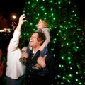 Cinthia Vlaovich takes a photo of her husband Dean Vlaovich and their son Nicholas Vlaovich, 3, all ...