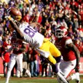 Louisiana State wide receiver Jarvis Landry makes a catch for a touchdown in front of Arkansas lineb...