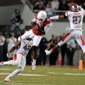 Arkansas wide receiver Brandon Mitchell catches the ball between Rutgers linebacker Steve Beauharnai...