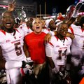 Rutgers head coach Kyle Flood and players celebrate following their 35-26 win over Arkansas on Satur...