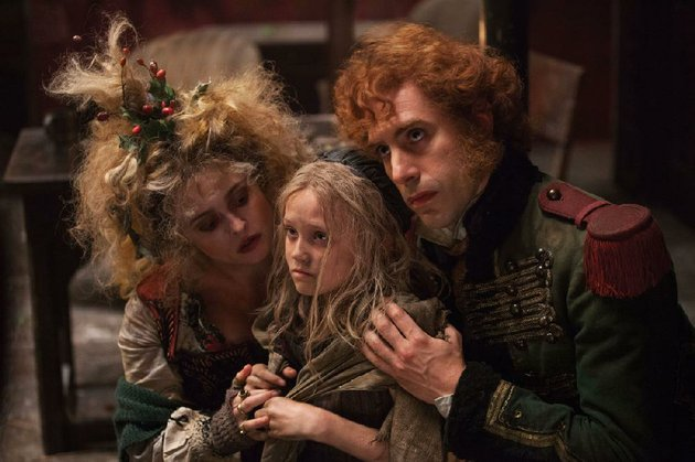 madame-thenardier-helena-bonham-carter-cosette-isabelle-allen-and-thenardier-sacha-baron-cohen-star-in-tom-hoopers-les-miserables
