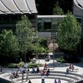 Students frolic outdoors after taking a tour of the Crystal Bridges Museum of American Art in Benton...