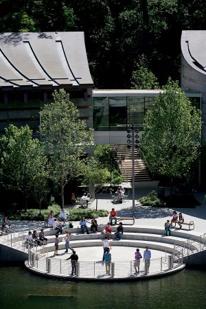 Students frolic outdoors after taking a tour of the Crystal Bridges Museum of American Art in Bentonville. The museum, which opened last November, has attracted about 604,000 visitors since its debut.