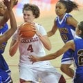 Arkansas forward Sarah Watkins drives to the hoop between Coppin State defenders (left to right) LAr...