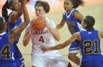 Arkansas forward Sarah Watkins drives to the hoop between Coppin State defenders (left to right) LArrisa Carter, Kyra Coleman, Amber Grifin and Shawntae Payne during the first half of Friday night's game at Bud Walton Arena in Fayetteville.