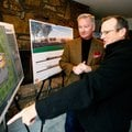 Mike Luttrell of Springdale and property owner Tom Lundstrum, left, look over the proposed site Dec....