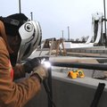 Everett Hice welds railings Thursday near one of the water slides at the Rogers aquatic center.
