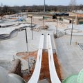 Progress on the Rogers aquatic center is seen Thursday from the top of its tallest water slide.