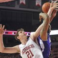 University of Arkansas forward Hunter Mickelson and Northwestern State forward DeQuan Hicks fight fo...