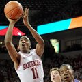 NWA Media/MICHAEL WOODS --12/29/2012-- University of Arkansas guard BJ Young drives to the hoop past...