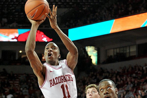 NWA Media/MICHAEL WOODS --12/29/2012-- University of Arkansas guard BJ Young drives to the hoop past Northwestern State forward DeQuan Hicks during the first half of Saturday night's game against the Demons at Bud Walton Arena in Fayetteville.