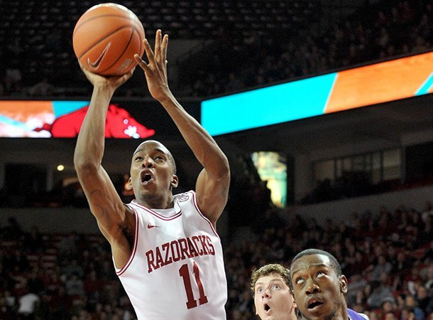 nwa-mediamichael-woods-12292012-university-of-arkansas-guard-bj-young-drives-to-the-hoop-past-northwestern-state-forward-dequan-hicks-during-the-first-half-of-saturday-nights-game-against-the-demons-at-bud-walton-arena-in-fayetteville