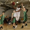 Bentonville's Jamayne Potts, center, takes the ball to the basket past Pierce City (Mo.) defender Sh...