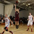 Springdale's Brittany Jurgens, center, puts an open shot up between Webb City (Mo.) defenders Mikael...