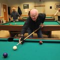 Sherman Stratton lines up a shot Friday during a game of eight-ball at the Benton County Senior Acti...