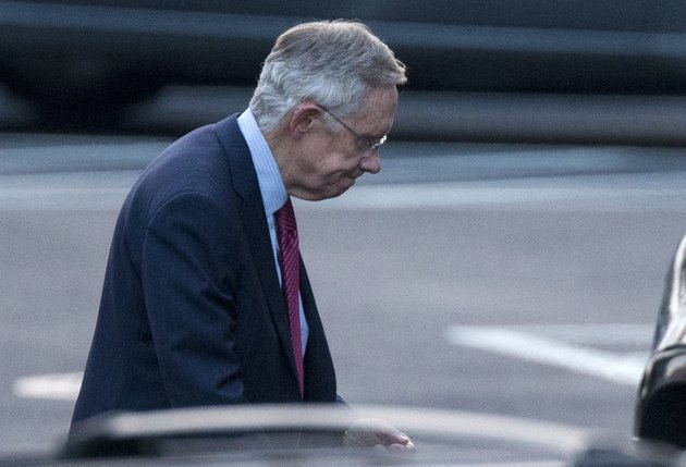 senate-majority-leader-harry-reid-of-nev-leaves-the-white-house-in-washington-friday-dec-28-2012-after-a-closed-door-meeting-between-president-barack-obama-and-congressional-leaders-to-negotiate-the-framework-for-a-deal-on-the-fiscal-cliff-the-end-game-at-hand-president-barack-obama-and-congressional-leaders-made-a-final-stab-at-compromise-friday-to-prevent-a-toxic-blend-of-middle-class-tax-increases-and-spending-cuts-from-taking-effect-at-the-turn-of-the-new-year