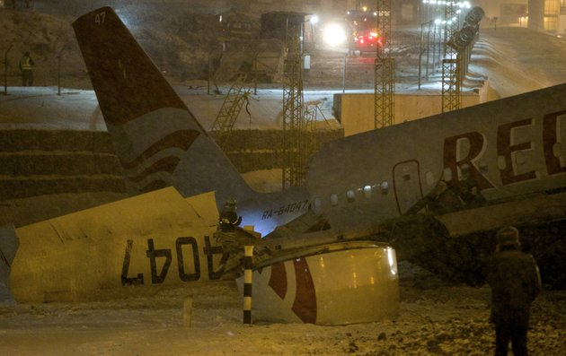 wreckage-of-a-plane-which-careered-off-the-runway-at-vnukovo-airport-in-moscow-saturday-dec-29-2012-a-tu-204-aircraft-belonging-to-russian-airline-red-wings-careered-off-the-runway-at-russias-third-busiest-airport-on-saturday-broke-into-pieces-and-caught-fire-killing-several-people