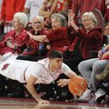 Kikko Haydar, an Arkansas junior, fights to keep a ball inbounds against Florida A&M in the first ha...