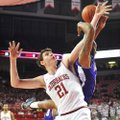 Arkansas forward Hunter Mickelson (21) and Northwestern State forward DeQuan Hicks (right) battle fo...