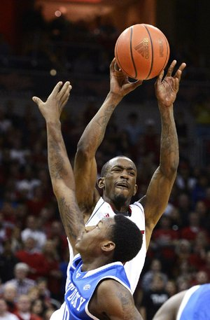 Louisville's Russ Smith (back) shoots over Kentucky's Archie Goodwin (Sylvan Hills) during the second half of the No. 4 Cardinals' 80-77 victory over the Wildcats on Saturday in Louisville, Ky.