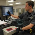 Deputy Mike Nugent shows on Friday how the Benton County Jail's fingerprinting equipment works.