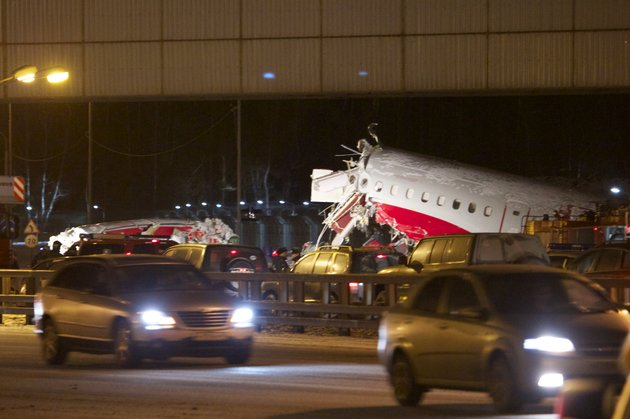 cars-travel-past-the-wreckage-of-a-plane-that-careered-off-the-runway-at-vnukovo-airport-in-moscow-saturday-dec-29-2012-a-tu-204-aircraft-belonging-to-russian-airline-red-wings-careered-off-the-runway-at-russias-third-busiest-airport-on-saturday-broke-into-pieces-and-caught-fire-killing-several-people