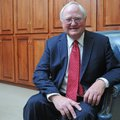 Jim Rollins, Springdale Public Schools superintendent, smiles Dec. 21 in his office at 804 W. Johnso...