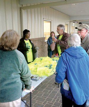 "Opponents of uranium mining in Virginia gather outside a Dec. 12 meeting near the proposed mine site, distributing neon yellow T-shirts that say ""Keep the Ban."""