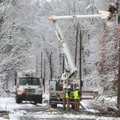 An Entergy Arkansas Inc., crew works to restore power to customers on Whittington Avenue near the en...