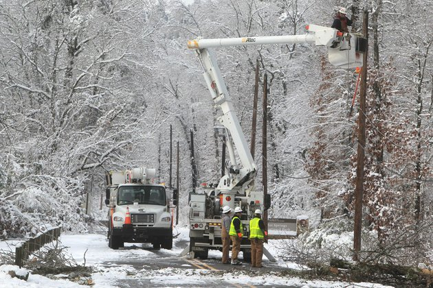 an-entergy-arkansas-inc-crew-works-to-restore-power-to-customers-on-whittington-avenue-near-the-entrance-to-hot-springs-national-park-thursday-dec-27-2012-in-hot-springs-ark