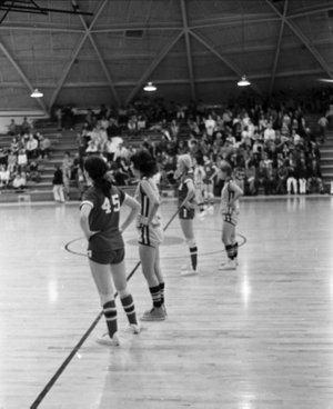 Before 1979, girls basketball in Arkansas was played halfcourt three-on-three. Players could not cross the center line. In this photo taken at the West Fork Tournament on Feb. 26. 1972, players stand at midcourt waiting on the ball to get to their end of the court.
