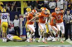 In this photo taken Dec. 31, 2012, Clemson's Chandler Catanzaro (39) and Spencer Benton (13) celebrate after Catanzaro kicked a 37-yard field goal as time expires to beat LSU 25-24 in the Chick-fil-A Bowl NCAA college football game at the Georgia Dome in Atlanta, Ga. (AP Photo/Anderson Independent-Mail, Mark Crammer)