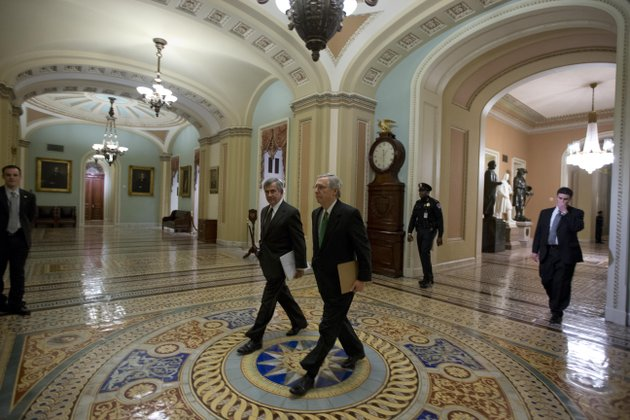 sen-mike-johanns-r-neb-left-walks-with-senate-minority-leader-mitch-mcconnell-from-kentucky-to-the-senate-floor-for-a-vote-on-the-fiscal-cliff-on-capitol-hill-tuesday-jan-1-2013-in-washington-the-senate-passed-legislation-early-new-years-day-to-neutralize-a-fiscal-cliff-combination-of-across-the-board-tax-increases-and-spending-cuts-that-kicked-in-at-midnight