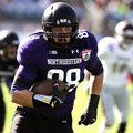 Northwestern defensive lineman Quentin Williams (88) returns a interception for a touchdown during t...
