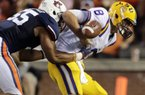 Auburn defensive end Corey Lemonier causes LSU quarterback Zach Mettenberger to fumble during the first half Sept. 22. Auburn recovered the fumble. (Associated Press)