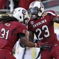 South Carolina wide receiver Bruce Ellington (23) celebrates with teammate Kenny Miles (31) after sc...