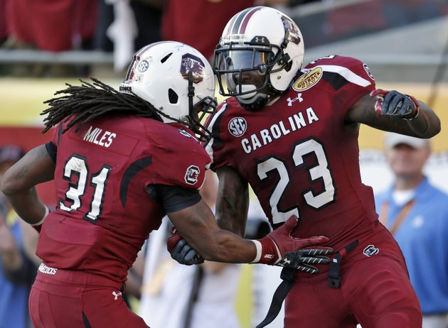 south-carolina-wide-receiver-bruce-ellington-23-celebrates-with-teammate-kenny-miles-31-after-scoring-on-a-32-yard-touchdown-reception-during-the-second-half-of-the-outback-bowl-ncaa-college-football-game-against-michigan-tuesday-jan-1-2013-in-tampa-fla-south-carolina-won-33-28-ap-photochris-omeara