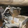 Steve Turner, a commercial cave expert from Tennessee, removes loose rock from War Eagle Cavern on N...