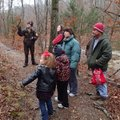 Rachel Diersen, left, interpretive naturalist at Hobbs State Park-Conservation Area, leads a New Yea...